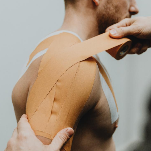 Therapist uses Zinc Oxide Tan 5cm tape on Rugby Player Shoulder