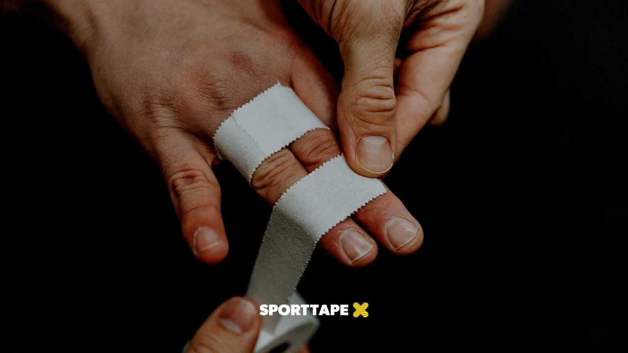 Athlete Finger Taping BJJ Climbing